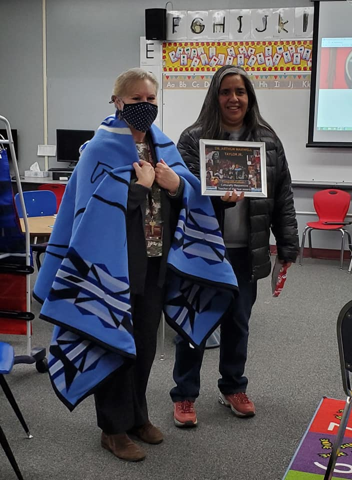 Image of teacher and Nez Perce Tribe Education manager