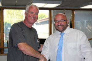 Dr. Merrill congratulates Mr. Smith on his 2021 VFW Teacher of the Year Award